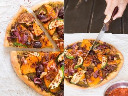 vegan-pizza-with-pumpkin-being-cut-800x598